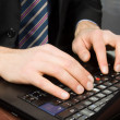 Businessman typing on a Personal Computer keyboard — Stok fotoğraf