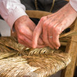 Traditional crafts - The chair-mender - Stock Photo