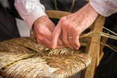 Traditional crafts - The chair-mender — Stock Photo
