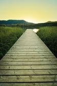 Sunset on the wooden pier of Lake Banyoles — Stock Photo