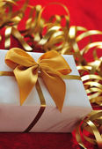 Gift in the package with ribbon — Stock Photo