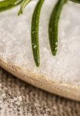 Salt on the wooden spoon — Stock Photo