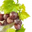 Fresh red grapes with leaves — Stock Photo