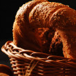 Bread with grain and ears in the basket — Stock Photo