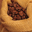 Coffee beans and canvas sack - close up — Stockfoto
