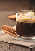 Creamy coffee in glass cup — Stock Photo