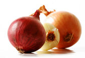 Three colors of onion on white background — Stock Photo
