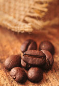 Coffee beans with linen sack — Stock Photo