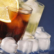 Cold beverages with ice cubes and lemon — Stock Photo #20020833