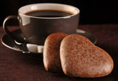 Gingerbread and brown coffee cup — Stock Photo