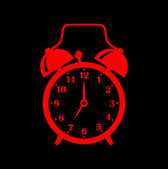 Red alarm clock on black background — Stock Vector