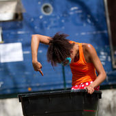 Dancer in a trash can. — Stock Photo