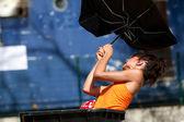 Actress holding an umbrella. — Stock Photo