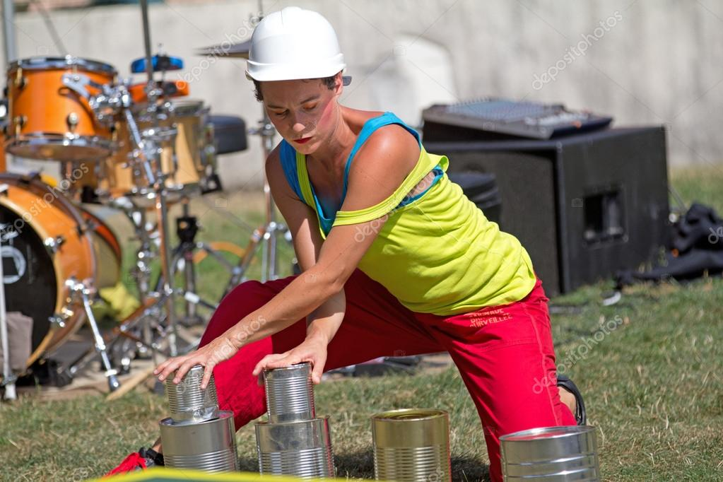 AURILLAC, FRANCE - AUGUST 23 : a comedian is playing with tins as part of the Aurillac International Street Theater Festival,show by the Company Empreintes, on august 23, 2012, in Aurillac,France.   Stock Photo #13875344