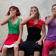 Stock Photo: Funny faces of three dancers on bench