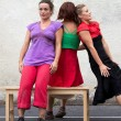Three dancers are standing around a bench — Stock Photo