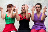Three dancers playing with their hands — Stock Photo