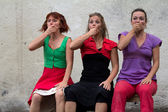 Funny faces of three dancers on a bench — Stock Photo