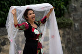 Woman holding a white veil — Stock Photo