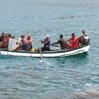 Stock Photo: Africmen on small boat.