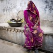 Stock Photo: Veiled womin India.
