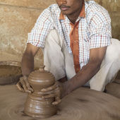 Indian potter working. — Stock Photo
