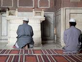 Two men kneeling to pray. — Stock Photo