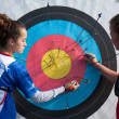 Stock Photo: Two competitors are checking their archery accuracy.