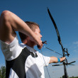 Stock Photo: Male competitor ready to shoot with bow and arrow.