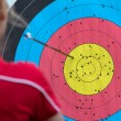 Stock Photo: Competitor checking her archery accuracy.
