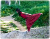 Woman keeping her balance on an old bridge. — Stock Photo