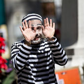 Clown showing his handcuffed hands. — Stock Photo