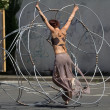 Dancer moving inside a metallic structure. — Stock Photo