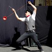 Actor playing diabolo. — Stock Photo