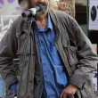 Stock Photo: Old singer in street.