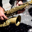 Very close-up portrait of a saxophone player. — Stock Photo