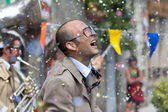 Hail of confetti on an actor. — Stock Photo