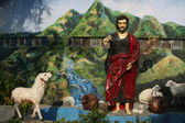 Sculpture of a shepherd leading his sheeps — Stock Photo