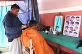 Hair shop in an open-air market. — Stock Photo