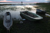 Twilight on the Itzal lake with three small boats moored on the edge. — Stock Photo