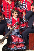 A little girl wears a traditional Andalusian red dress. — Stock Photo