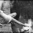 Romantic dancer on the edge of a pond. — Stock Photo