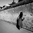 Stock Photo: Dancer along old wall.