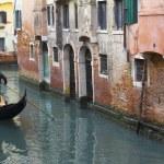 Gondola in a narrow canal in Venice — Stock Photo #9867473