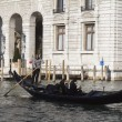 Gondolier driving a gondola with passengers — Stock Photo #9867580