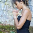 Close-up portrait of a young woman who is praying. — Stock Photo #9973360