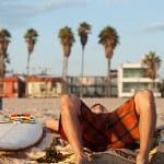 Surfer lying on the beach — Stock Photo #13057380