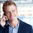Closeup portrait of handsome business man using cell phone, smil — Stock Photo