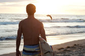 Surfer at the beach — Stock Photo