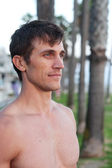 Portrait of an active young man at beach — Stock Photo